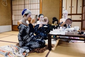 Trainee geishas doing their makeup together